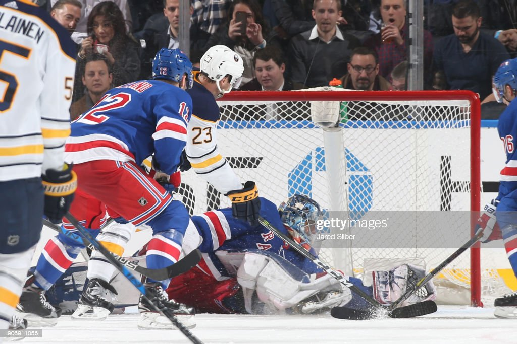 Henrik Lundqvist #30 of the New York Rangers makes a save against Sam Reinhart #23 of the Buffalo Sabres late in the game at Madison Square Garden on January 18, 2018 in New York City.