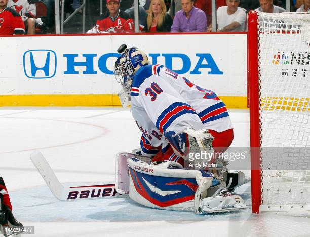 Henrik Lundqvist of the New York Rangers makes a save against the New Jersey Devils in Game Six of the Eastern Conference Final during the 2012 NHL...