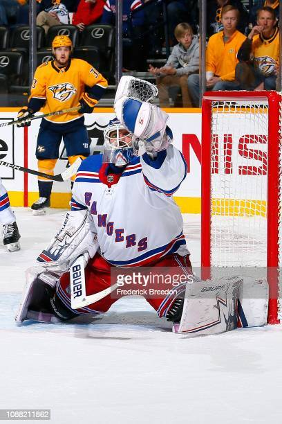Henrik Lundqvist of the New York Rangers makes a save against the Nashville Predators during the first period at Bridgestone Arena on December 29...