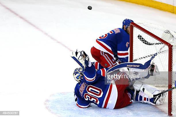 Henrik Lundqvist of the New York Rangers makes a save against the Montreal Canadiens during Game Six of the Eastern Conference Final in the 2014 NHL...