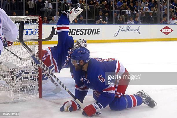 Henrik Lundqvist of the New York Rangers makes a save against the Montreal Canadiens in the second period during Game Six of the Eastern Conference...