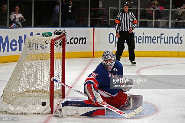 Henrik Lundqvist of the New York Rangers makes a save against the Atlanta Thrashers in the first period of game four of the 2007 Eastern Conference...