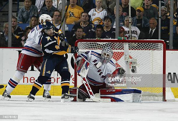 Henrik Lundqvist of the New York Rangers makes a save as Brendan Shanahan defends Daniel Briere of the Buffalo Sabres during Game 5 of the 2007...