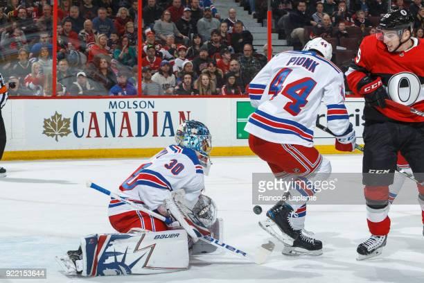 Henrik Lundqvist of the New York Rangers makes a save as Neal Pionk defends against Matt Duchene of the Ottawa Senators at Canadian Tire Centre on...