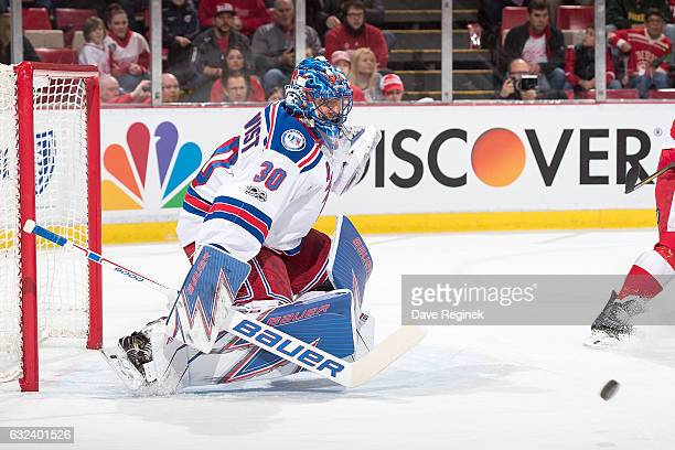 Henrik Lundqvist of the New York Rangers makes a save during an NHL game against the Detroit Red Wings at Joe Louis Arena on January 22 2017 in...