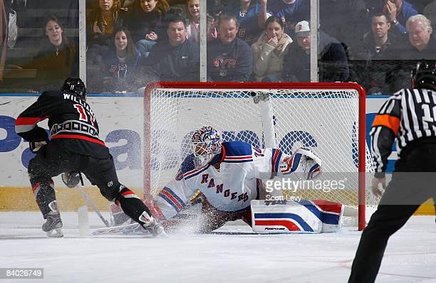 Henrik Lundqvist of the New York Rangers makes a save in a shootout against Justin Williams of the Carolina Hurricanes on December 13 2008 at Madison...
