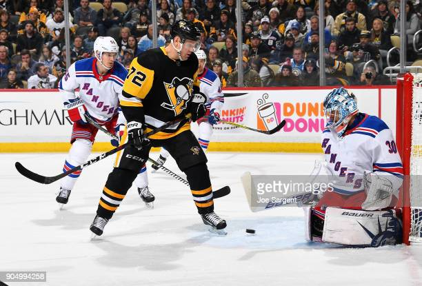 Henrik Lundqvist of the New York Rangers makes a save in front of Patric Hornqvist of the Pittsburgh Penguins at PPG Paints Arena on January 14 2018...
