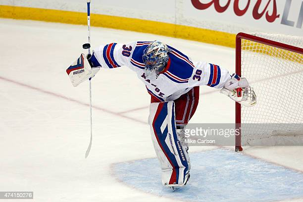 Henrik Lundqvist of the New York Rangers makes a save in the first period against the Tampa Bay Lightning during Game Three of the Eastern Conference...