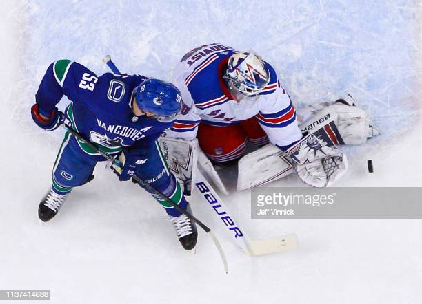 Henrik Lundqvist of the New York Rangers makes a save off the shot of Bo Horvat of the Vancouver Canucks during their NHL game at Rogers Arena March...