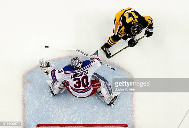 Henrik Lundqvist of the New York Rangers makes a save on Bryan Rust of the Pittsburgh Penguins in Game Two of the Eastern Conference Quarterfinals...
