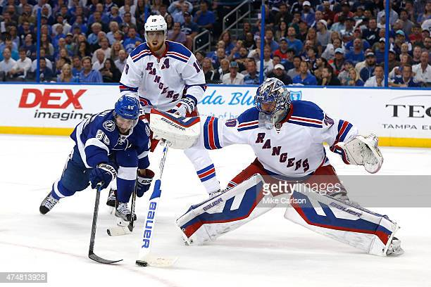 Henrik Lundqvist of the New York Rangers makes a stick save against Nikita Kucherov of the Tampa Bay Lightning during the second period in Game Six...