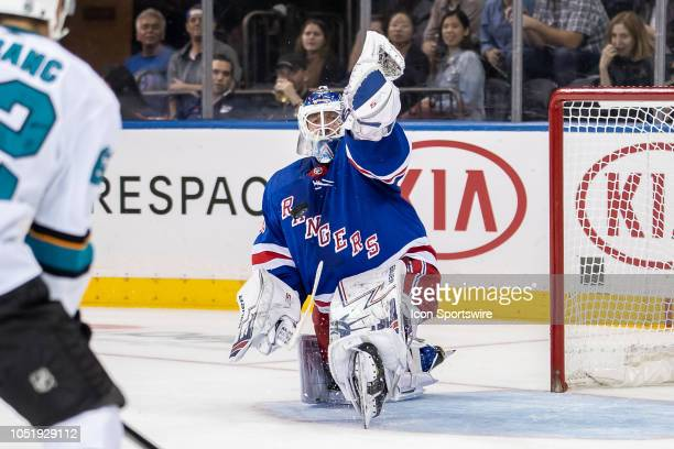 Henrik Lundqvist of the New York Rangers makes a stunning glove save during a game between the New York Rangers and the San Jose Sharks on October 11...