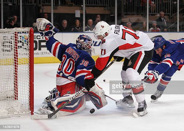 Henrik Lundqvist of the New York Rangers makes the first period save on Filip Kuba of the Ottawa Senators in Game Two of the Eastern Conference...