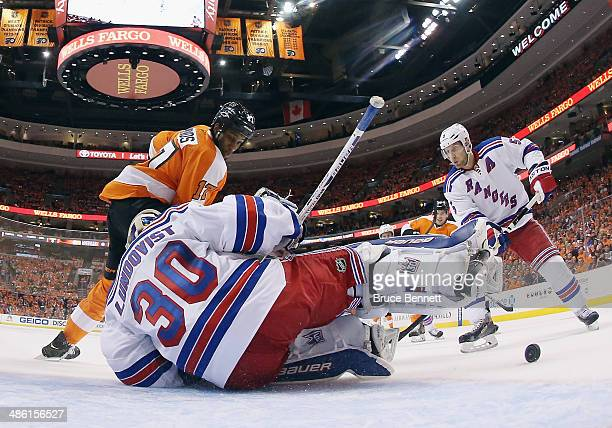 Henrik Lundqvist of the New York Rangers makes the first period save as Wayne Simmonds of the Philadelphia Flyers looks for the rebound in Game Three...