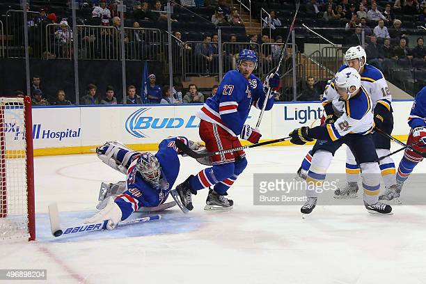 Henrik Lundqvist of the New York Rangers makes the first period stick save on Alexander Steen of the St. Louis Blues at Madison Square Garden on...