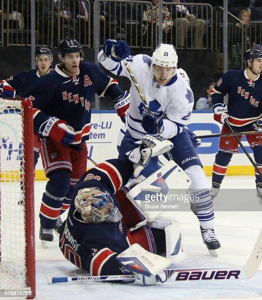 Henrik Lundqvist of the New York Rangers makes the first period stop on James van Riemsdyk of the Toronto Maple Leafs at Madison Square Garden on...