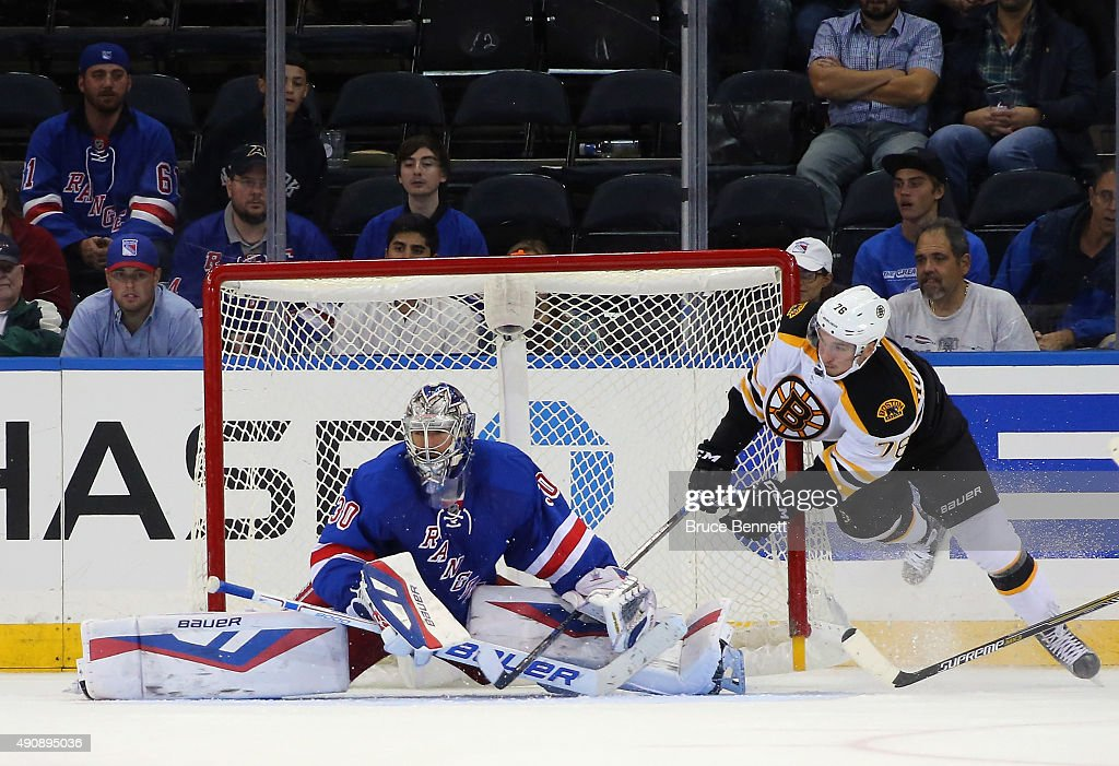Henrik Lundqvist #30 of the New York Rangers makes the save as Alexander Khokhlachev #76 of the Boston Bruins looses his footing at Madison Square Garden on September 30, 2015 in New York City.