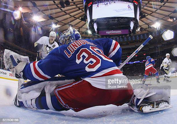 Henrik Lundqvist of the New York Rangers makes the save on Evgeni Malkin of the Pittsburgh Penguins in Game Three of the Eastern Conference First...