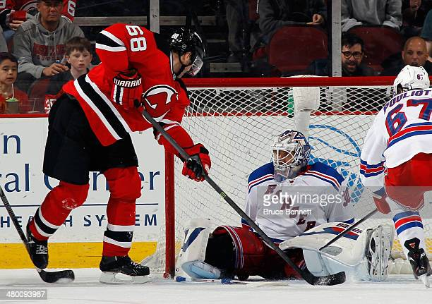 Henrik Lundqvist of the New York Rangers makes the save on Jaromir Jagr of the New Jersey Devils in the closing minutes of their game at the...