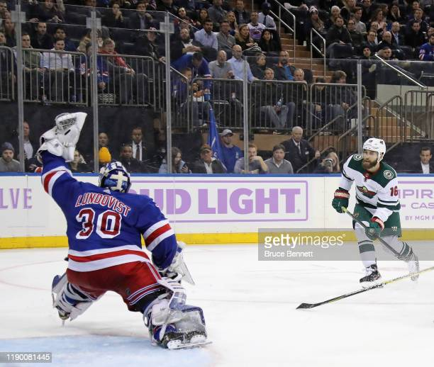Henrik Lundqvist of the New York Rangers makes the save on Jason Zucker of the Minnesota Wild at Madison Square Garden on November 25, 2019 in New...