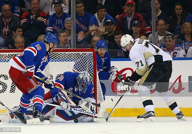 Henrik Lundqvist of the New York Rangers makes the second period save on Evgeni Malkin of the Pittsburgh Penguins in Game One of the Eastern...