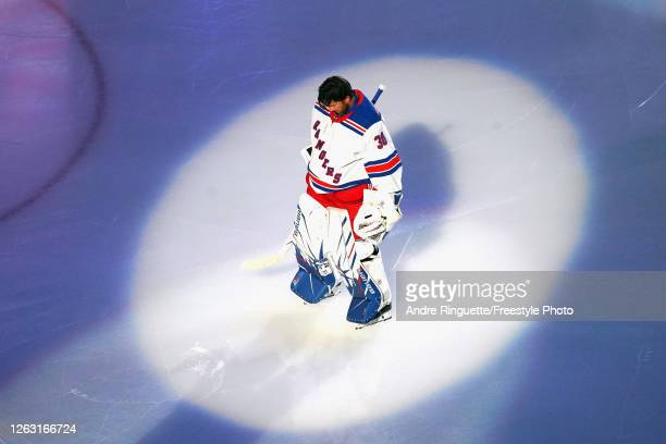 Henrik Lundqvist of the New York Rangers prepares to start in the nets against the Carolina Hurricanes in Game One of the Eastern Conference...