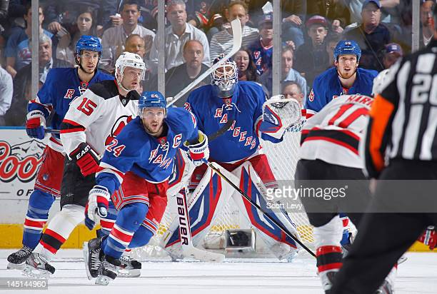 Henrik Lundqvist of the New York Rangers protects the net against Petr Sykora of the New Jersey Devils in Game Two of the Eastern Conference Final...