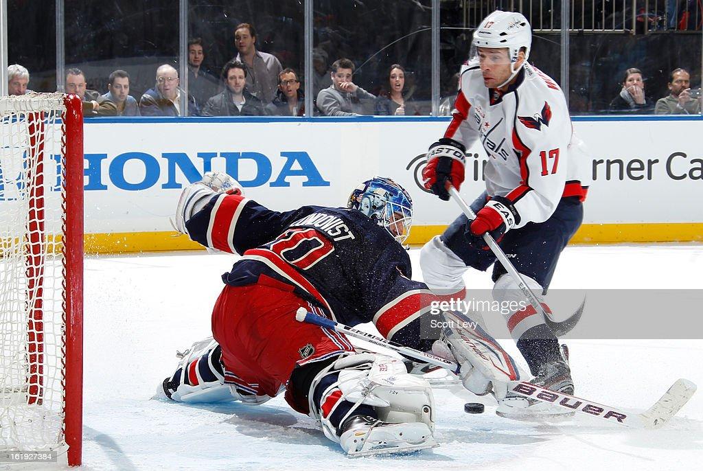 Henrik Lundqvist #30 of the New York Rangers protects the net against Wojtek Wolski #17 of the Washington Capitals at Madison Square Garden on February 17, 2013 in New York City.