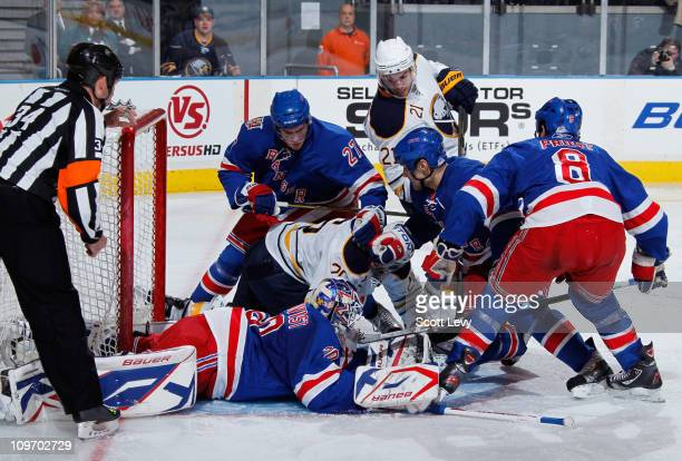 Henrik Lundqvist of the New York Rangers protects the net in the second period against Thomas Vanek of the Buffalo Sabres on March 1, 2011 at Madison...