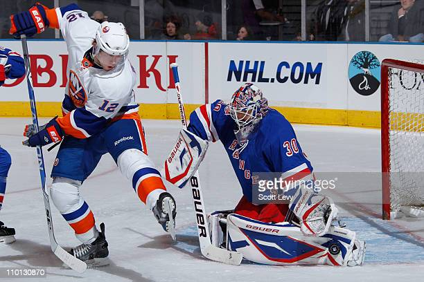 Henrik Lundqvist of the New York Rangers protects the net in the first period against Josh Bailey of the New York Islanders on March 15 2011 at...