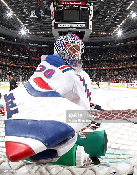 Henrik Lundqvist of the New York Rangers reached for his water bottle prior to a game against the Ottawa Senators at Scotiabank Place on January 10,...