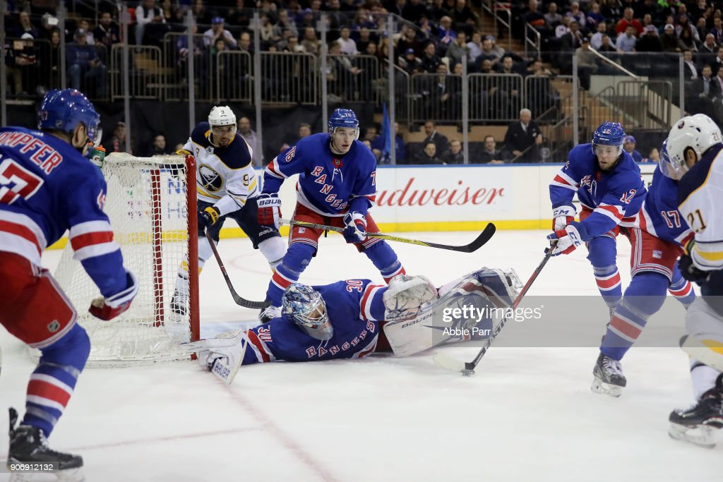 Henrik Lundqvist #30 of the New York Rangers reaches to block a shot by Kyle Okposo #21 of the Buffalo Sabres in the third period during their game at Madison Square Garden on January 18, 2018 in New York City.