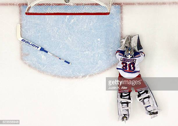 Henrik Lundqvist of the New York Rangers reacts after a second period goal by Bryan Rust of the Pittsburgh Penguins in Game Five of the Eastern...