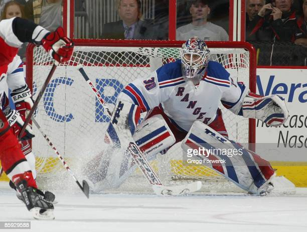 Henrik Lundqvist of the New York Rangers readies himself to make a save during a NHL game against the Carolina Hurricanes on April 2 2009 at RBC...