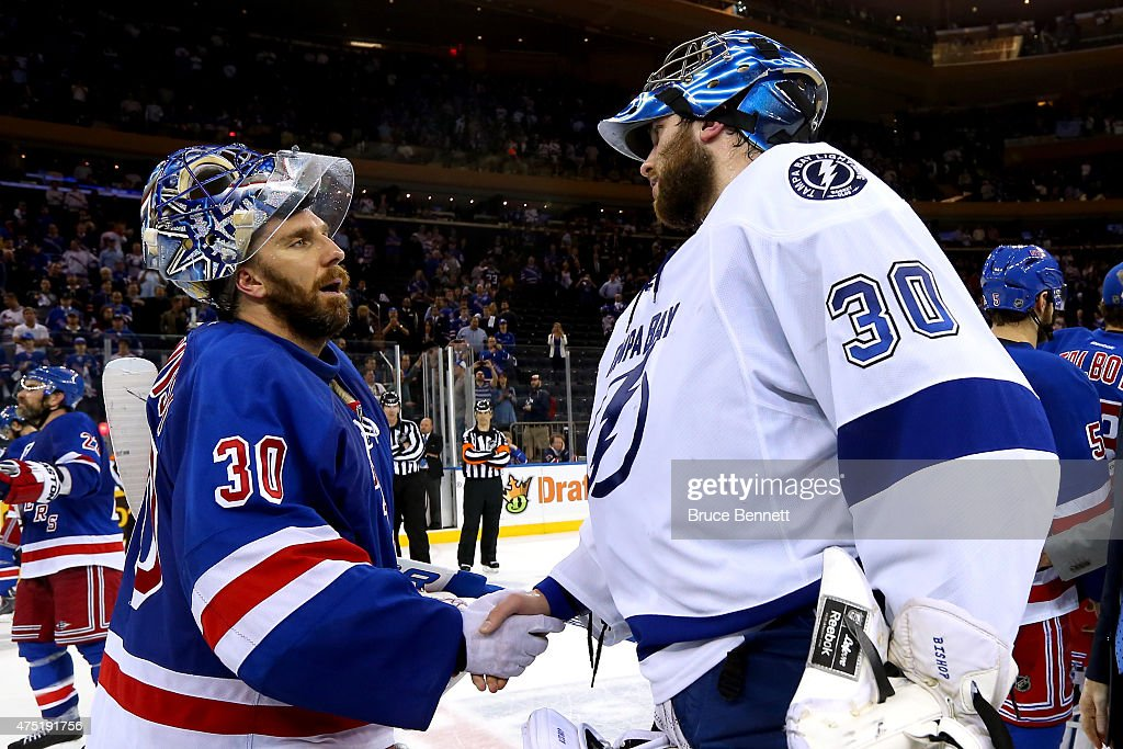 Henrik Lundqvist #30 of the New York Rangers shakes hands with Ben Bishop #30 of the Tampa Bay Lightning after the rangers lost by a score of 2-0 in Game Seven of the Eastern Conference Finals during the 2015 NHL Stanley Cup Playoffs at Madison Square Garden on May 29, 2015 in New York City.