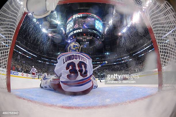 Henrik Lundqvist of the New York Rangers sits in the crease after giving up the game-winning goal to Dustin Brown of the Los Angeles Kings in the...