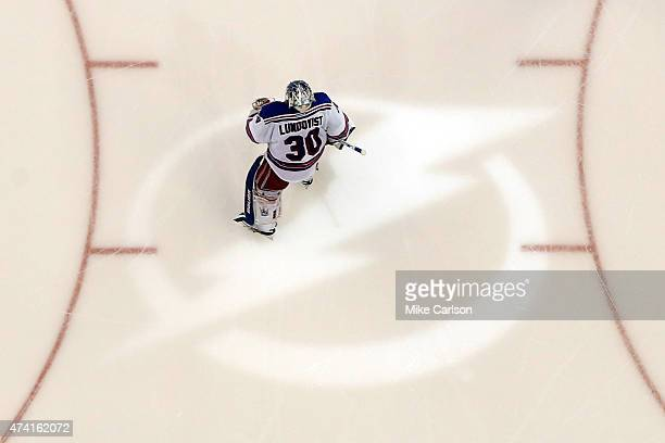 Henrik Lundqvist of the New York Rangers skates across the Tampa Bay Lightning logo after being defeated in overtime by the Tampa Bay Lightning 5 to...
