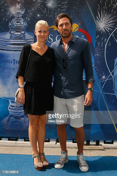Henrik Lundqvist of the New York Rangers smiles alongside his wife Therese Andersson while attending Day Six of the 2013 US Open at the USTA Billie...