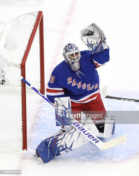Henrik Lundqvist of the New York Rangers stops a shot in the second period against the New York Islanders during an exhibition game prior to the 2020...