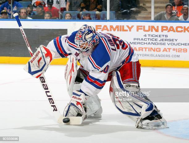 Henrik Lundqvist of the New York Rangers stops the puck with his goal stick blade against the New York Islanders on October 28, 2009 at Nassau...