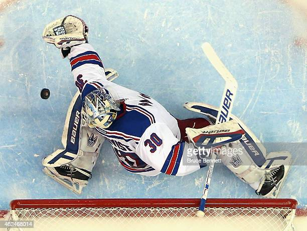 Henrik Lundqvist of the New York Rangers tends net against the New York Islanders at the Nassau Veterans Memorial Coliseum on January 27 2015 in...