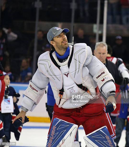 Henrik Lundqvist of the New York Rangers throws tshirts to fans following the Rangers final regular season game against the Detroit Red Wings at...