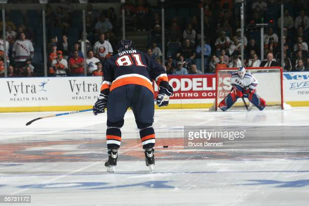 Henrik Lundqvist of the New York Rangers waits for Miroslav Satan of the New York Islanders to take a shot during the shootout in a preseason game on...