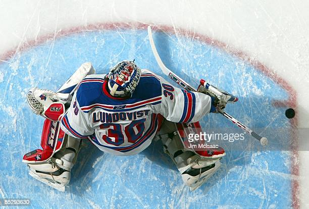 Henrik Lundqvist of the New York Rangers warms up before playing against the New York Islanders on March 5, 2009 at Nassau Coliseum in Uniondale, New...