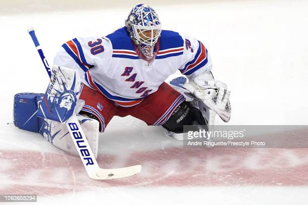 Henrik Lundqvist of the New York Rangers warms up prior to Game Two of the Eastern Conference Qualification Round against the Carolina Hurricanes...