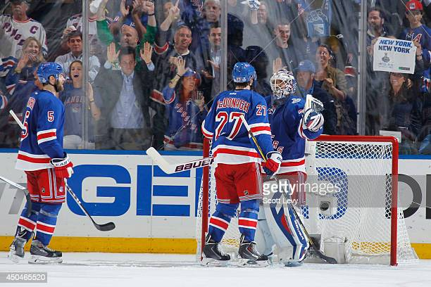 Henrik Lundqvist, Ryan McDonagh and Dan Girardi of the New York Rangers celebrate after a 2-1 win over the Los Angeles Kings during Game Four of the...