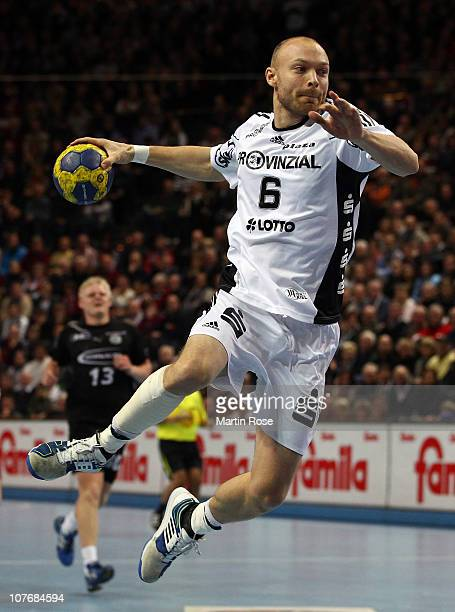 Henrik Lundstroem of Kiel throws at goal the Toyota Handball Bundesliga match between THW Kiel and VfL Gummersbach at the Sparkassen Arena on...