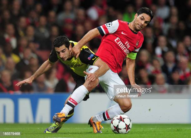 Henrik Mkhitaryan of Borussia Dortmund and Mikel Arteta of Arsenal battle for the ball during the UEFA Champions League Group F match between Arsenal...