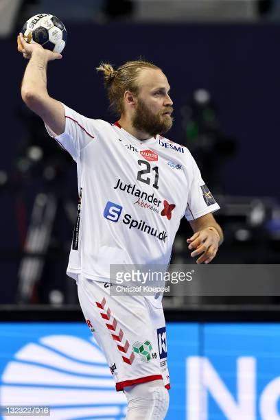 Henrik Moellgaard of Aalborg Handbold passes the ball during the VELUX EHF Champions League FINAL4 semi-final between Aalborg Handbold v Paris...