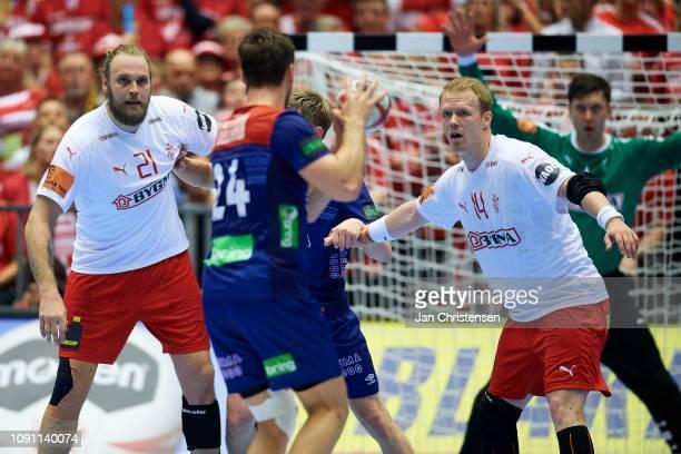 Henrik Mollgaard of Denmark and Anders Zachariassen of Denmark defend during the IHF Men's World Championships Handball Final between Denmark and...